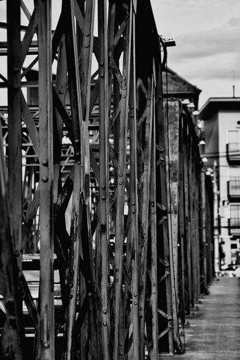 Close-up of bridge against buildings