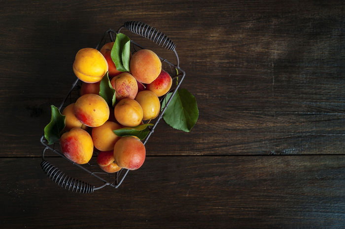 Fresh appricots on a wooden table Apricots Golden Appricots Close-up Food Food And Drink Fresh Freshness Fruit Healthy Eating Leaf Leaves Multi Colored No People Rustic Studio Shot Summer Table Table Top Wood - Material Wood Table