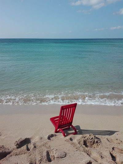Chair on shore at beach