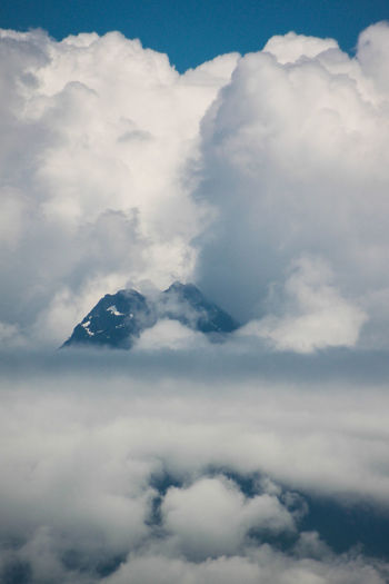 Aerial View Beauty In Nature Blue Cloud - Sky Cloudscape Cloudy Cumulus Cloud Day Fluffy High Up Idyllic Majestic Mountain Mountain Range Nature Non-urban Scene Scenics Sky Softness Surrounding Tranquil Scene Tranquility White Color