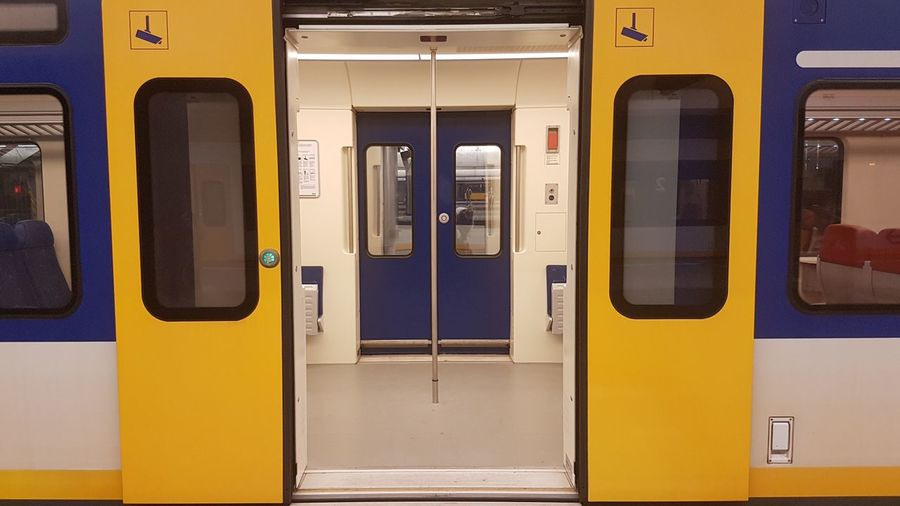 Open yellow door of train