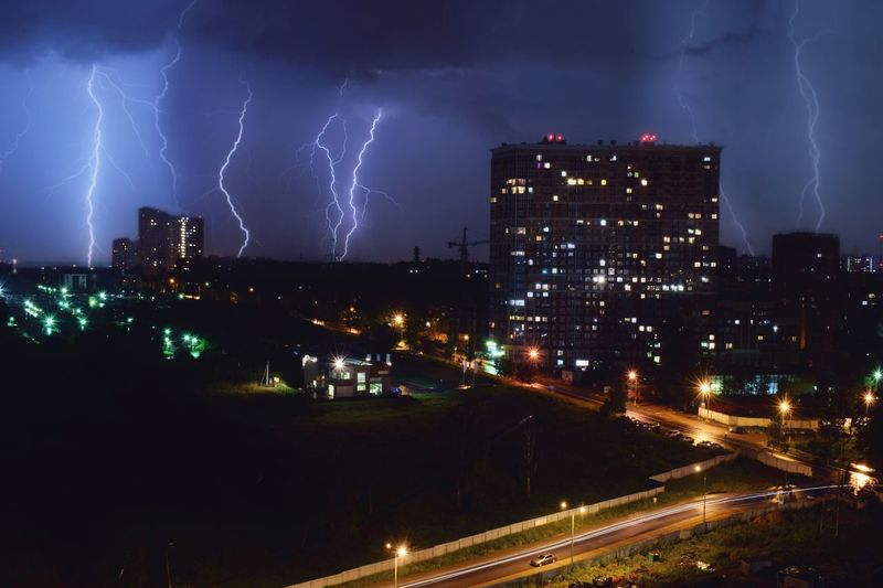 Lightning over city against at night