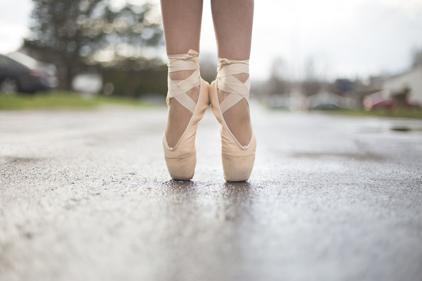 A ballerina in ballet shoes in the street. Artist Beautiful Beautiful Nature Dance Dancing Road Ballet Concert Dancer Feet Ground Human Body Part Human Leg Low Section Lower Half Pavement Pink Color Shoes Street Toes Breathing Space