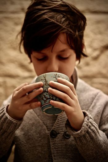 Eduard sipping hot chocolate during winter Holidays EyeEmNewHere Family Hibernation Holiday Sipping Boy Boys Casual Clothing Childhood Close-up Cozy Cup Drinking Focus On Foreground Headshot Holding Hot Drinks One Boy Only One Person People Portrait Real People Warm Warm Clothing Warm Winter
