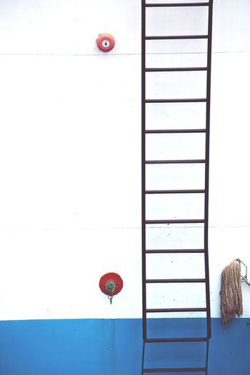 Cropped image of ladder on ship