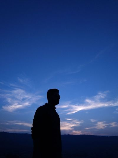 person Shadow Sky Blue Sky Sillouette Sunset Dusk Dawn One Person Unknown Person Politics And Government Men Silhouette Religion Sky Sky Only Spirituality Exploring Fun
