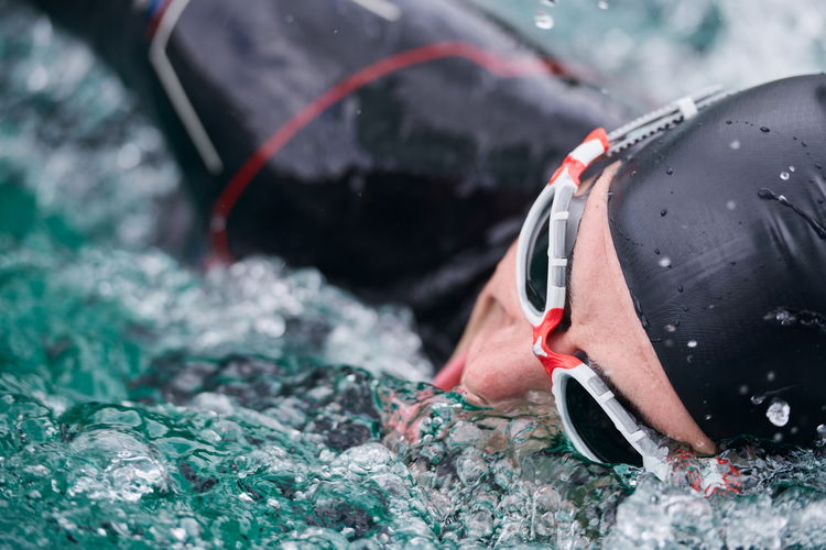 Close-up of man swimming in pool