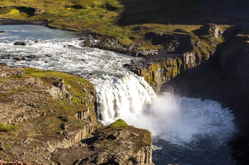 Spot the tiny fellow :) Waterfall Nature Beauty In Nature Water Motion Scenics Rock - Object Power In Nature No People River Day Outdoors Cliff Hafragilsfoss Travel Destinations Rock Formation Iceland