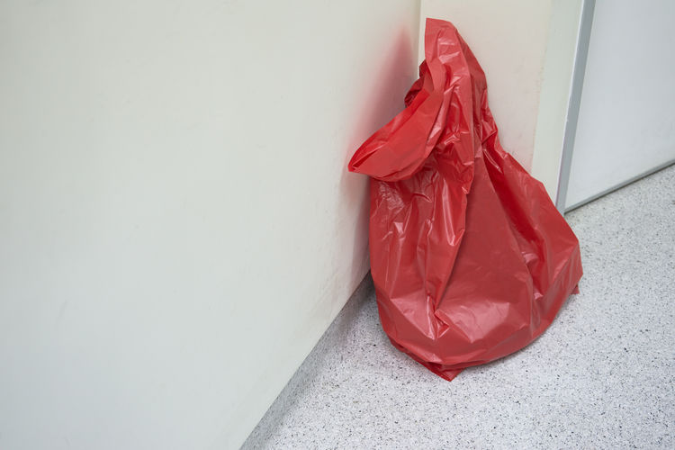 A red plastic bag in operating room Biohazard Medicine Wall Bag Dirty Garbage Bin Harzard Health Healthcare And Medicine Indoors  Infectious Operating Room Plastic Bag Protection Red Surgery Untied Wall - Building Feature