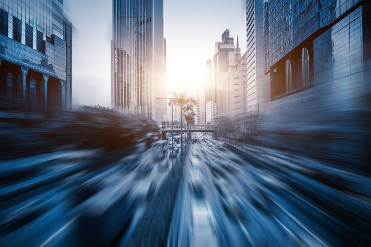 Blurred motion of street and buildings in city