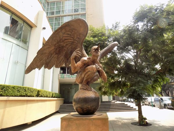 Hombre Alado, Wing Man Artistic Freedom No Filter Sunlight Urban Scene Walking Around Architecture Art And Craft Building Exterior Day No People Outdoors Sculpture Statue Street Streetart Streetphotography Wingman Wings