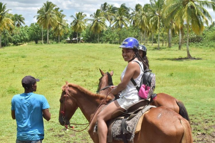 Perspectives On Nature Palm Tree Tree Horse Mammal Riding Horseback Riding Domestic Animals Field One Animal Day Nature Two People Leisure Activity Outdoors Women Grass Lifestyles Sitting Helmet Adult