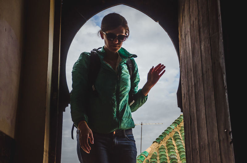 Young man wearing sunglasses standing outdoors