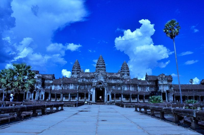 ASIA Angkor Wat, Cambodia Angkor Wat Architectural Column Architecture Blue Building Building Exterior Built Structure Cloud - Sky Direction Footpath History Nature No People Outdoors Place Of Worship Plant Sky The Past The Way Forward Travel Travel Destinations Tree