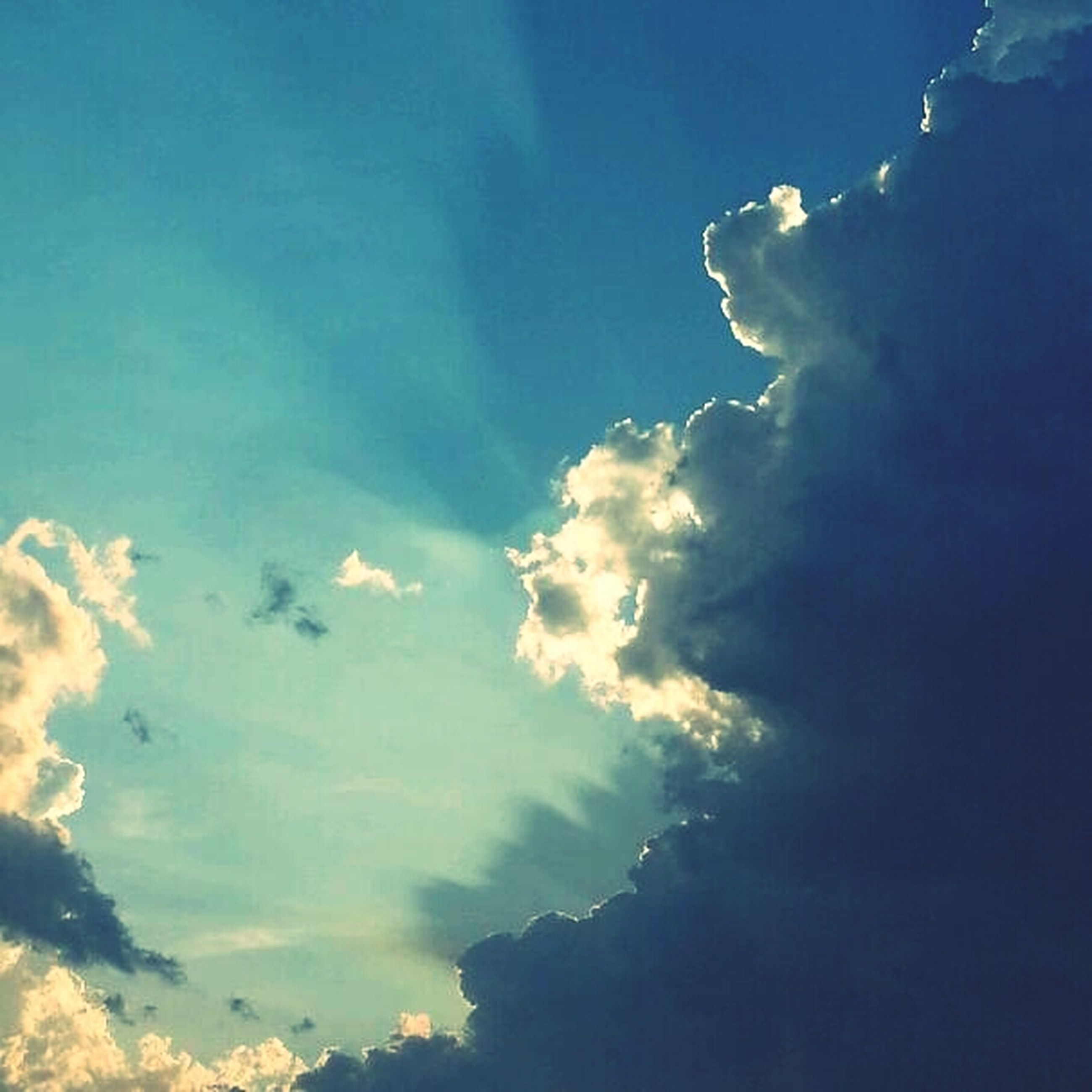 sky, blue, beauty in nature, scenics, tranquility, tranquil scene, cloud - sky, low angle view, nature, idyllic, cloud, outdoors, cloudscape, majestic, no people, sky only, cloudy, day, sunlight, weather