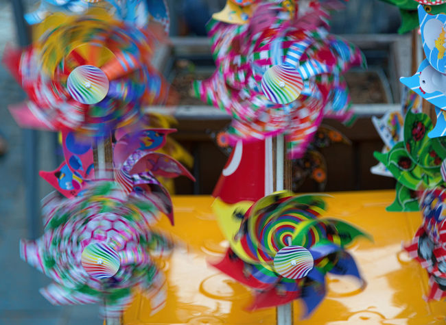 Pin Wheels Bright Colors Motion Blur Rainbow Colors Abundance Choice Colorful For Sale Large Group Of Objects Motion Capture Multi Colored Pin Wheel Retail  Spin Spinning Around Toy Variation Windy