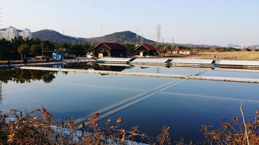 Artificial pond with mountains in background