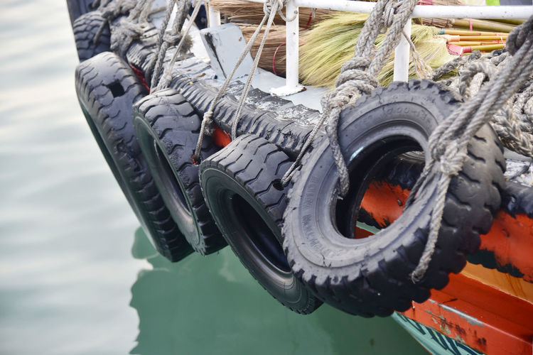 Close-up of rope tied to boat moored in lake