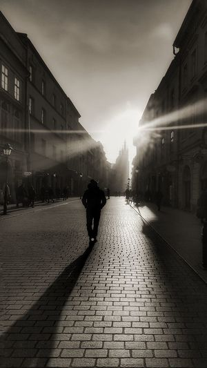 Going down the only road I've ever known. Ways Of Seeing Shadow-art Silhouettes And Shadows Silhouette Of A Man Cobbled Streets Long Shadow Sunset In City Old City Street Old Town Old Buildings Krakow Trenchcoat Man In Hat Blavk And White Monotone Been There. Sunrays Lensflare The Week On EyeEm Perspectives Monochrome Photography Lost In The Landscape Black And White Friday Colour Your Horizn This Is Masculinity Stories From The City The Street Photographer - 2018 EyeEm Awards The Traveler - 2018 EyeEm Awards