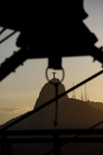 Brazil City Cityscape Cristo Redentor Rio De Janeiro Architecture Building Exterior Built Structure Day Low Angle View Mountain Nature No People Outdoors Religious Architecture Roof Silhouette Sky Sky Colors South America Sunset Tiled Roof
