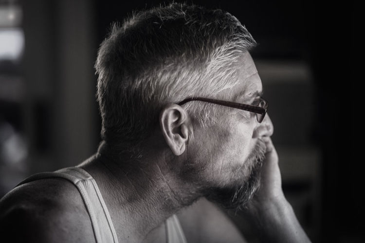 Close-up of thoughtful mature man at home
