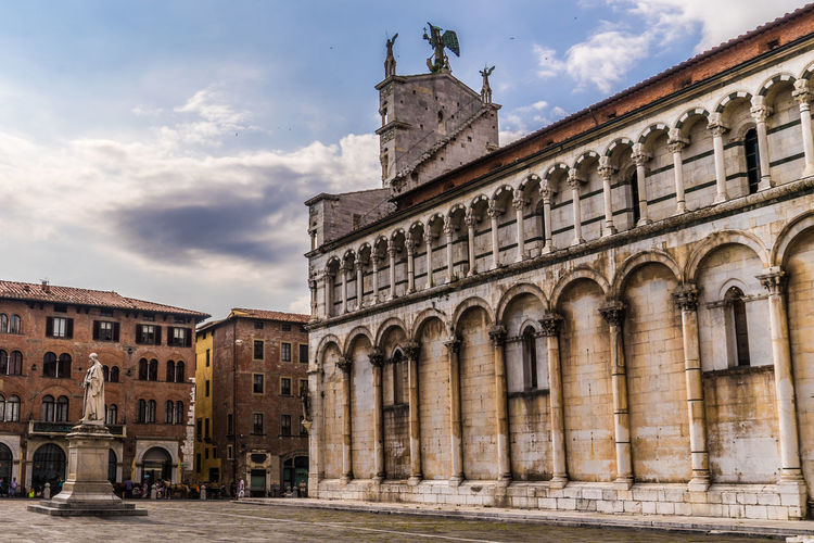Lucca, Italy Arch Architectural Column Architecture Art And Craft Building Building Exterior Built Structure City Cloud - Sky Day History Human Representation Low Angle View Nature No People Outdoors Sculpture Sky Statue The Past Travel Travel Destinations
