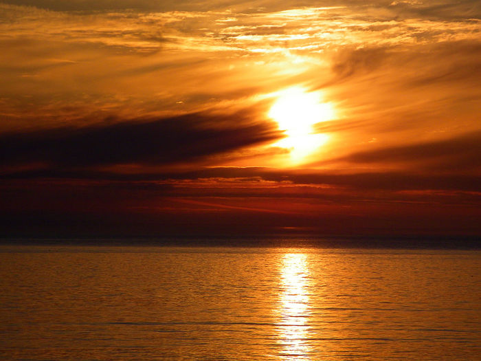 Fire in the Sky Water Sea Sunset Beauty Gold Colored Awe Sunlight Sun Beach Ethereal Refraction Romantic Sky Seascape Tide Coast Wave Coastal Feature Dramatic Sky Moody Sky Sky Only