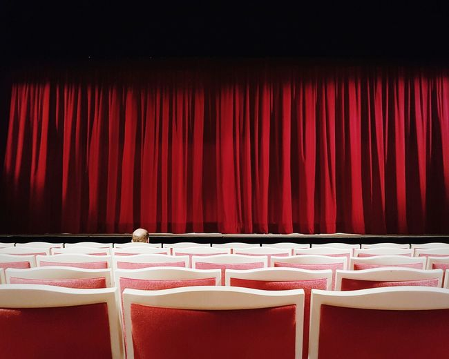 Stage - Performance Space Curtain Red Theatrical Performance Stage Theater Arts Culture And Entertainment Performing Arts Event Event Performance Movie Theater Film Industry Auditorium Audience Premiere Chair Seat Incidental People Human Head Back Lit Nightlife Showing Indoors  Red Carpet Event EyeEm Gallery