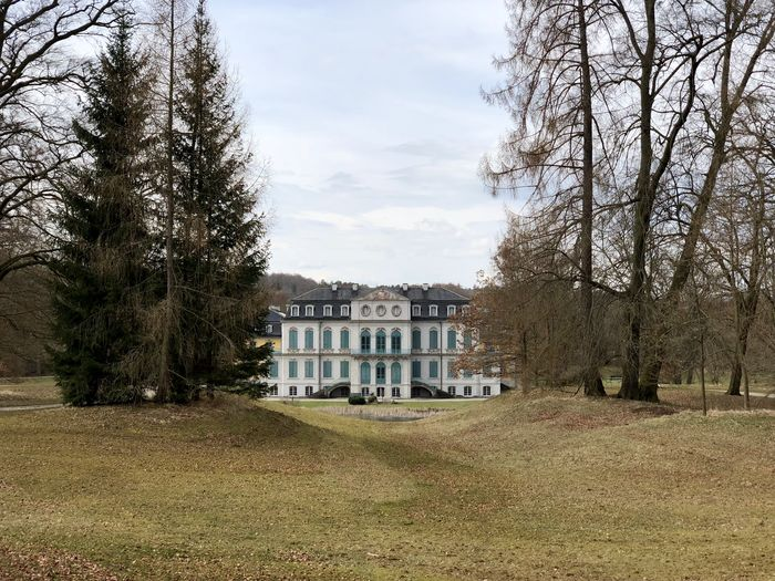 Schloss Wilhelmstal Architecture Bare Tree Building Building Exterior Built Structure Cloud - Sky Day Field Grass Growth House Land Nature No People Outdoors Plant Residential District Sky Travel Destinations Tree