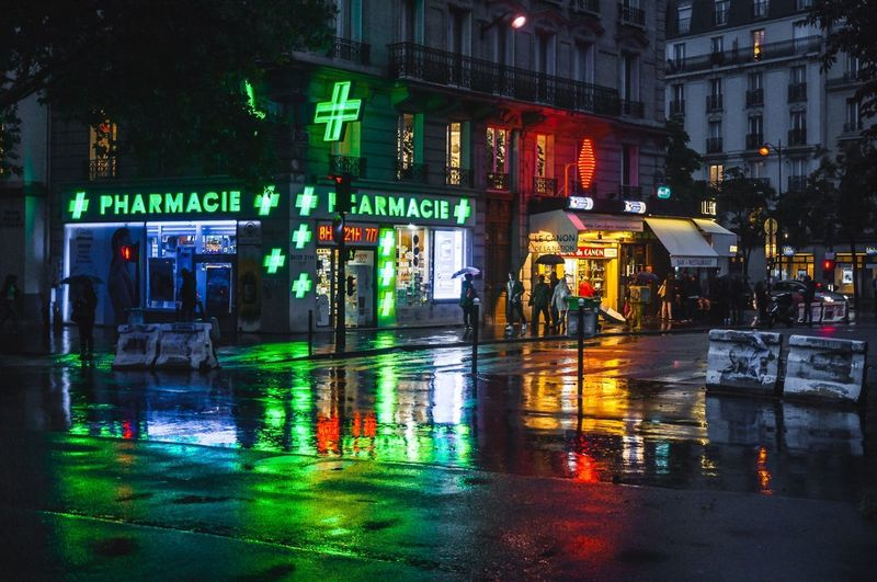 Home sweet home Colors Paris, France  Nightphotography Night Neon Lights Light Photographer Photography Reflection Illuminated Reflection Built Structure Architecture Night Building Exterior Real People Outdoors City Wet People Water