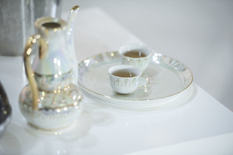 Close-Up Of Teapot And Cups On Table During Wedding