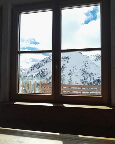 landscape true the Windows Dolomites, Italy Col Margherita Marmolada Sky Snow Winter Holidays City Cityscape Tree Snow Winter Mountain Cold Temperature Window Looking Through Window Sky