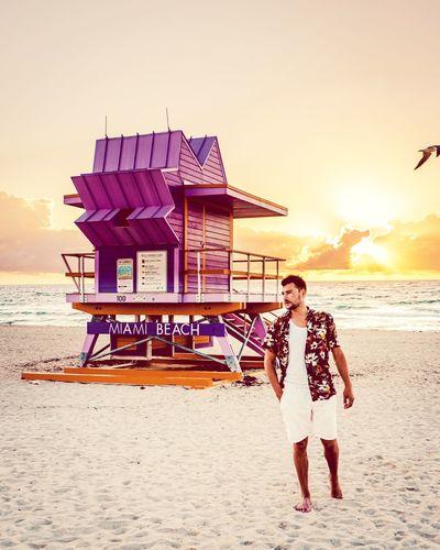 Miami Miami Beach Miami South Beach Men Man Sunrise Sea Water Beach Sunset Sand Standing Summer Men Lifeguard  Lifeguard Hut Beach Hut Coastline Surfer Coastal Feature Marram Grass Hooded Beach Chair Rocky Coastline Ocean Seascape Headland Thatched Roof Shore Sandy Beach Wave