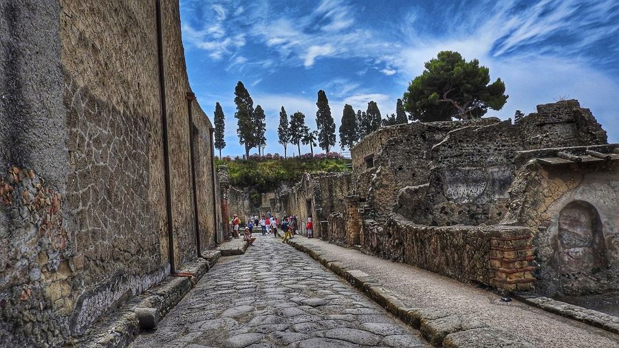 Alleyview at Herculaneum excavations, Italy Alley Archaelogical Excavations Architecture Blue Built Structure Cloud Cloud - Sky Day Diminishing Perspective Herculaneum Narrow No People Outdoors Sky The Way Forward Tree UNESCO World Heritage Site Vanishing Point