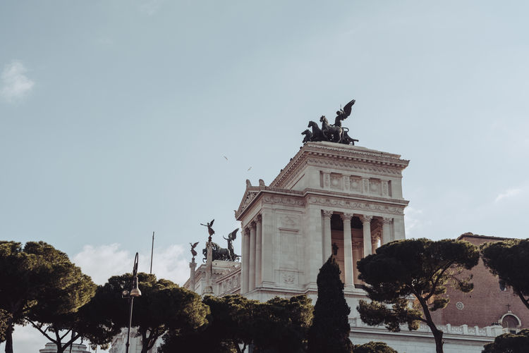 the national monument in rome Sky Architecture Built Structure Building Exterior Tree Nature Plant Cloud - Sky No People The Past History Travel Destinations Low Angle View Sculpture Statue Art And Craft Day Travel Representation Architectural Column Outdoors National Monument Lazio Roma City Center