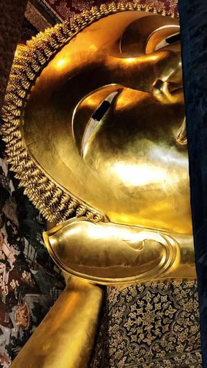Reclining Buddha. The biggest one in Thailand Gold Colored No People Close-up Shiny Indoors  Art And Craft EyeEmNewHere Metal Sculpture Gold Creativity