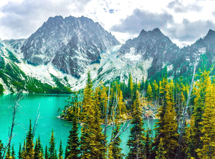 Colchuck Lake in Autumn Autumn Beauty In Nature Cloud - Sky Colchuck Lake Day Emerald Forest Freshness Glacier Green Growth Lake Landscape Mountain Mountain Range Nature No People Outdoors Reflection Scenics Sky Tranquil Scene Tranquility Tree Water