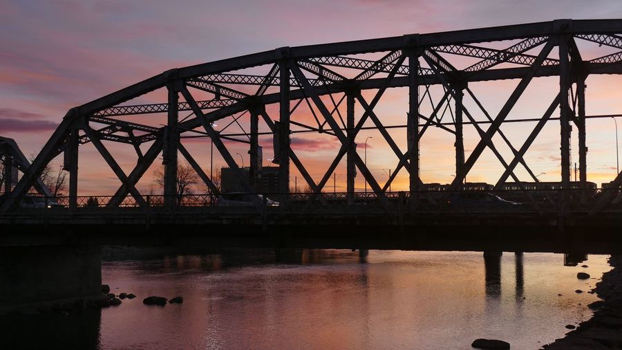 EyeEm Selects Dawn on the Reconiliation (Langevin) Bridge. Bridge - Man Made Structure Dawn Morning Light Morning Sky Morning Commute Salmon Colored Bow River Sunrise Sunrise Silhouette Transportation River Some People Girder Built Structure Sky Water Outdoors City Life