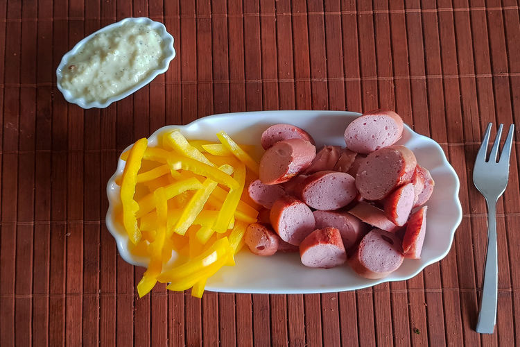 Viennese sausages with yellow peppers cut into strips as French fries substitutes. Low carb food Food Food And Drink Freshness Table Ready-to-eat Directly Above Still Life No People High Angle View Plate Indoors  Bowl Kitchen Utensil Healthy Eating Eating Utensil Wellbeing Meal Dairy Product Wood - Material Breakfast Temptation
