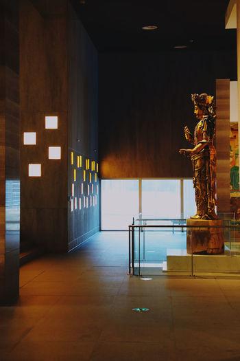 Statue in illuminated building