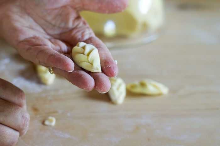 delicious italian tortelli preparation Close-up Day Dough Food Food And Drink Food Stories Freshness Healthy Eating Holding Human Body Part Human Hand Indoors  Italian Food Kneading One Person Pasta People Preparation  Real People Stuffed Pasta Table Tortelli