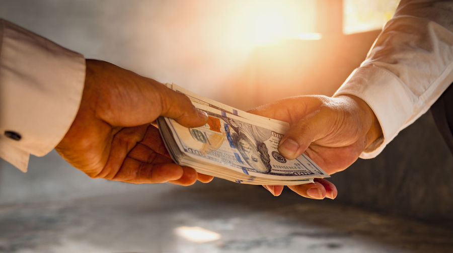 Businessmen give money to his partner, business concept. Human Hand Hand Currency Business Finance Paper Currency Holding Human Body Part Men Wealth Two People People Giving Close-up Savings Paying Males  Real People Indoors  Investment