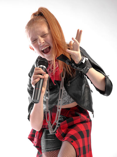 I love rock n roll Girl Singer  Sing Singing Red Hir Red Head Microphone White Background Child Childhood Smiling Girls Happiness Red Cheerful Standing Studio Shot Dyed Red Hair Redhead Green Eyes Freckle Pink Hair Dyed Hair Rock Musician Music Concert Rock Music Moments Of Happiness My Best Photo International Women's Day 2019 Exploring Fun The Portraitist - 2019 EyeEm Awards