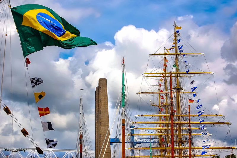 Port de la Penfeld Arts Culture And Entertainment Blue Boat Flag Flags In The Wind  Fêtes Maritimes Harbour Low Angle View Mast Mode Of Transport Nautical Vessel Outdoors Rope Sailboat Ship Sky Transportation Travel
