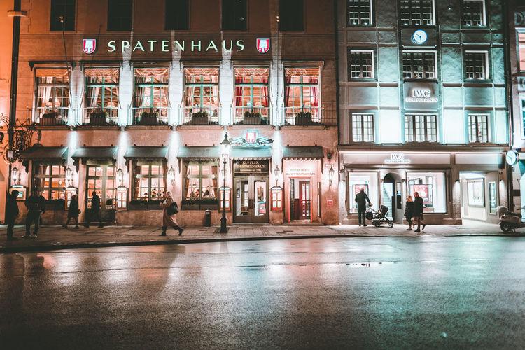 Illuminated building in city at night