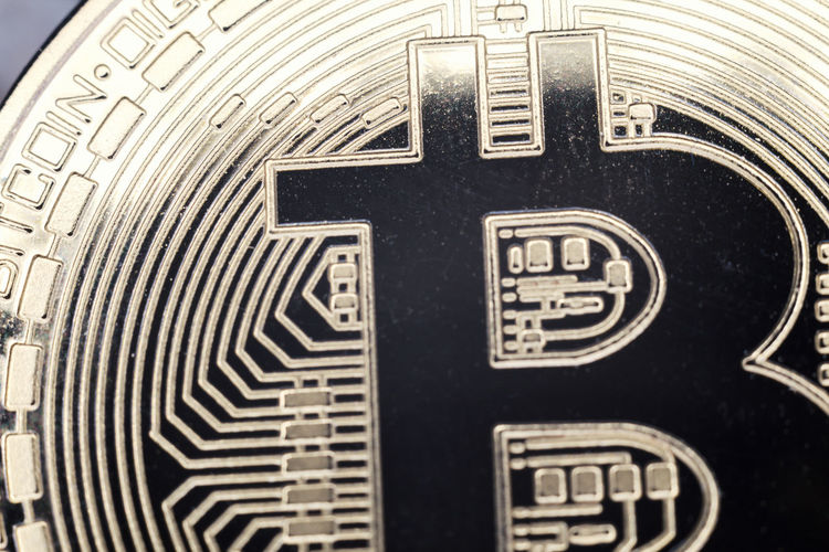 Bitcoin macro minted coin in gold, future currency. Backgrounds Bitcoin Black Color Close Up Close-up Communication Day Decentralized Detail Digital Currency Focus On Foreground Full Frame High Angle View Indoors  Macro Metal No People Number Pattern Selective Focus Sign Still Life Technology Text Western Script
