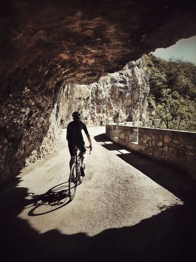 Cycling in the French Alps Tunnel Contrast Rocks Climbing Mountain Transportation Mode Of Transportation Real People Motion Sunlight EyeEmNewHere