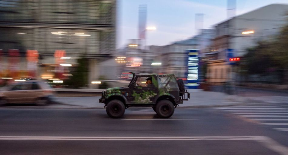 Military Car Motion Speed Transportation Motion Blurred Motion Road Mode Of Transportation Street City City Life Outdoors Land Vehicle Architecture Building Exterior City Street Illuminated Speed Dusk Built Structure Night Wet