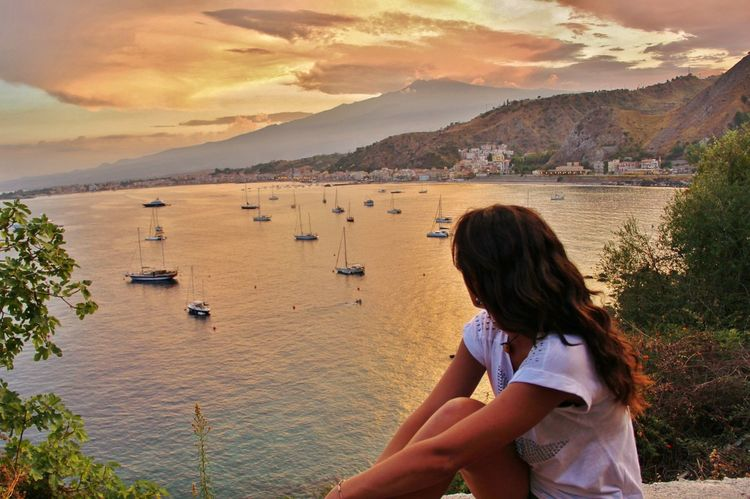 Beautiful Sicily Portrait Mediterranean  Mediterranean Sea Sea Seascape Sicily Taormina And Etna Boat Sea And Sky Beautiful Landscape Warm Colors Girl Sicily, Italy Moment Relax Relaxing Moments Relaxing Time Sunset One Person Rear View Outdoors Landscape Vacations Travel Summer Travel Destinations Women Cloud - Sky Standing An Eye For Travel