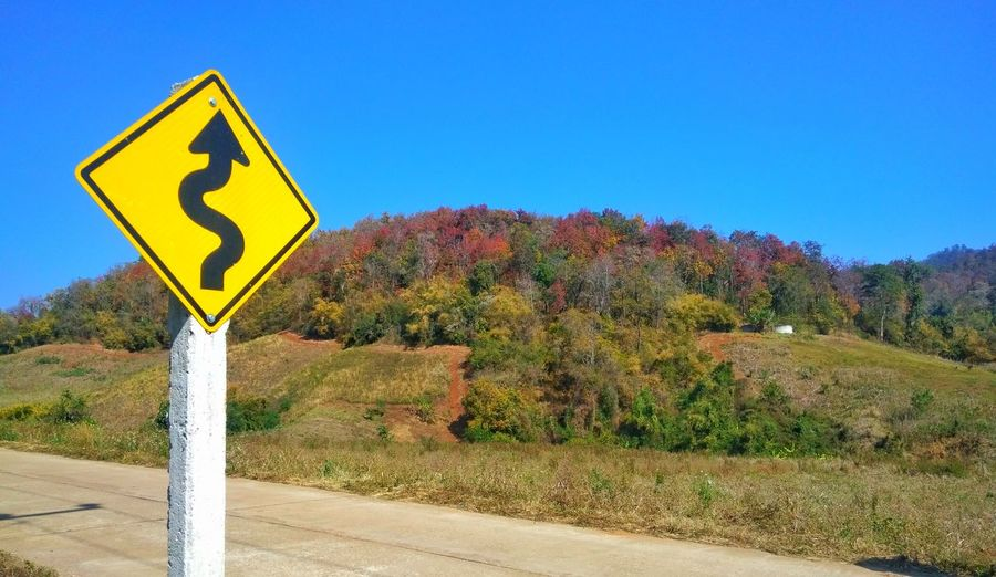 Blue Road Sign Outdoors No People Symbol Day Nature Sky Season ChangeRoad Signs Roadside Roadandscenery Forest View Fall Colors Fall Seasons Leaf Change Vivo V3 Max Road